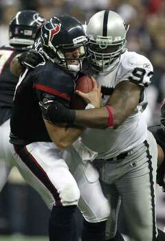 Houston Texans quarterback Matt Schaub (8) is sacked by Oakland Raiders defensive tackle Tommy Kelly (93) in the fourth quarter of an NFL football game at Reliant Stadium on Sunday, Oct. 9, 2011, in Houston. The Oakland Raiders won 25-20. Photo: Nick De La Torre, Houston Chronicle / © 2011  Houston Chronicle