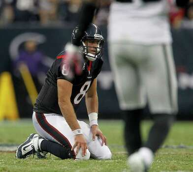 Houston Texans quarterback Matt Schaub (8) kneels on the turf  in the fourth quarter of an NFL football game at Reliant Stadium, Sunday, Oct. 9, 2011, in Houston. Raiders won the game 25-20. Photo: Karen Warren, Houston Chronicle / © 2011 Houston Chronicle