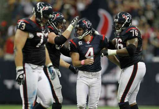 Houston Texans kicker Neil Rackers (4) is congratulated by teammates after his field goal in the third quarter of an NFL football game at Reliant Stadium, Sunday, Oct. 9, 2011, in Houston. Photo: Karen Warren, Houston Chronicle / © 2011 Houston Chronicle