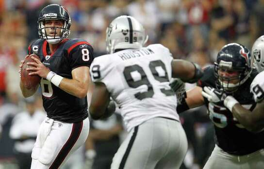 Houston Texans quarterback Matt Schaub (8) looks for a receiver in the fourth quarter of an NFL football game at Reliant Stadium, Sunday, Oct. 9, 2011, in Houston. Raiders won the game 25-20. Photo: Karen Warren, Houston Chronicle / © 2011 Houston Chronicle