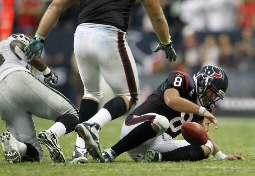Houston Texans quarterback Matt Schaub (8) pulls himself off the turf after getting sacked in the fourth quarter of an NFL football game at Reliant Stadium, Sunday, Oct. 9, 2011, in Houston. Raiders won the game 25-20. Photo: Karen Warren, Houston Chronicle / © 2011 Houston Chronicle