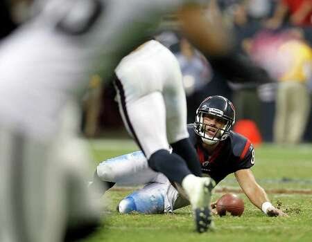 Houston Texans quarterback Matt Schaub (8) looks up from the turf after he recovered the ball after a missed snap in the fourth quarter of an NFL football game at Reliant Stadium, Sunday, Oct. 9, 2011, in Houston. Raiders won the game 25-20. Photo: Karen Warren, Houston Chronicle / © 2011 Houston Chronicle
