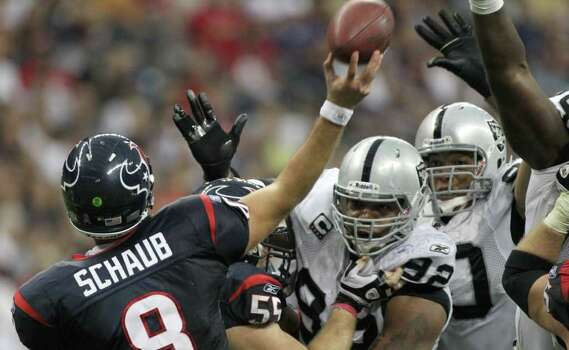 Oakland Raiders defensive tackle Richard Seymour (92), center, and Oakland Raiders defensive tackle Desmond Bryant (90) kept Houston Texans quarterback Matt Schaub (8) under duress during the fourth quarter of an NFL football game at Reliant Stadium on Sunday, Oct. 9, 2011, in Houston. The Oakland Raiders won 25-20. Photo: Nick De La Torre, Houston Chronicle / © 2011  Houston Chronicle