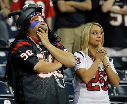 Houston Texans fans deject after the Texans loss to the Oakland Raiders after an NFL football game at Reliant Stadium, Sunday, Oct. 9, 2011, in Houston. Raiders won the game 25-20. Photo: Karen Warren, Houston Chronicle / © 2011 Houston Chronicle