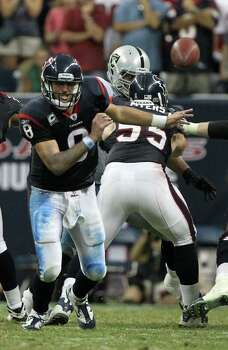 Houston Texans quarterback Matt Schaub (8) has to retrieve a shotgun snap he mis-handled during the fourth quarter of an NFL football game against the Oakland Raiders at Reliant Stadium on Sunday, Oct. 9, 2011, in Houston. The Oakland Raiders won 25-20. Photo: Nick De La Torre, Houston Chronicle / © 2011  Houston Chronicle