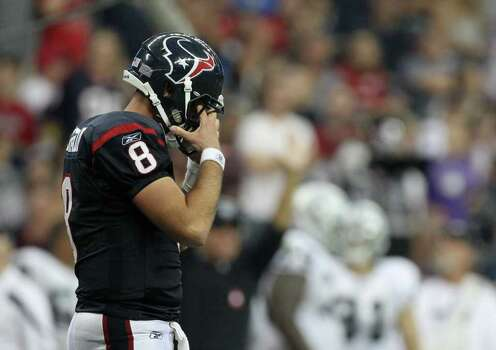 Houston Texans quarterback Matt Schaub (8) wipes sweat from his eyes as he tries to make a come back drive during the fourth quarter of an NFL football game against the Oakland Raiders at Reliant Stadium on Sunday, Oct. 9, 2011, in Houston. The Oakland Raiders won 25-20. Photo: Nick De La Torre, Houston Chronicle / © 2011  Houston Chronicle