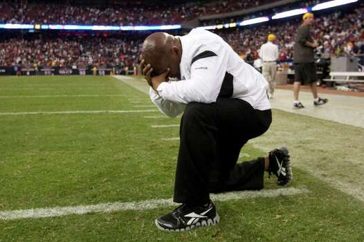 Oakland Raiders head coach Hue Jackson kneels on the field as he reacts the the Raiders win over the Houston Texans in an NFL football game at Reliant Stadium on Sunday, Oct. 9, 2011, in Houston. The Raiders beat the Texans 25-20. Photo: Brett Coomer, Houston Chronicle / © 2011  Houston Chronicle