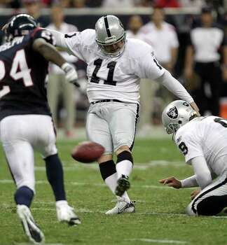 Oakland Raiders kicker Sebastian Janikowski (11) kicks a 50-yard field goal against the Houston Texans during the third quarter of an NFL football game at Reliant Stadium on Sunday, Oct. 9, 2011, in Houston. The Raiders beat the Texans 25-20. Photo: Brett Coomer, Houston Chronicle / © 2011  Houston Chronicle