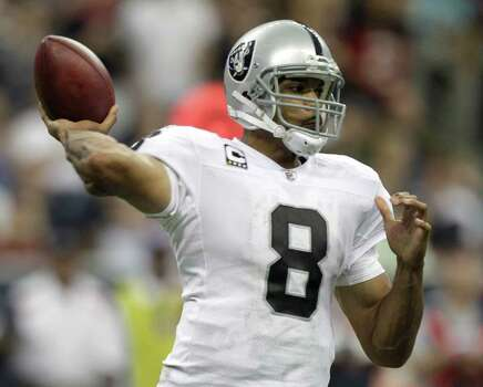 Oakland Raiders quarterback Jason Campbell (8) throws a pass against the Houston Texans during the fourth quarter of an NFL football game at Reliant Stadium on Sunday, Oct. 9, 2011, in Houston. The Raiders beat the Texans 25-20. Photo: Brett Coomer, Houston Chronicle / © 2011  Houston Chronicle