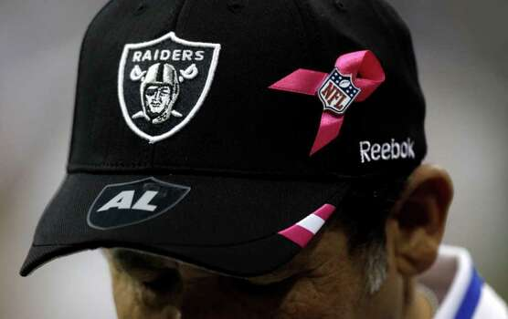 Oakland Raiders team photographer Tony Gonzales wears a sticker on his hat honoring Al Davis, the Raiders owner, during the third quarter of an NFL football game at Reliant Stadium on Sunday, Oct. 9, 2011, in Houston. The Raiders beat the Texans 25-20. Davis died Saturday. Photo: Brett Coomer, Houston Chronicle / © 2011  Houston Chronicle