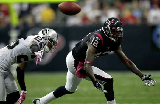 Oakland Raiders cornerback Stanford Routt (26) breaks up a pass intended for Houston Texans wide receiver Jacoby Jones (12) during the third quarter of an NFL football game at Reliant Stadium on Sunday, Oct. 9, 2011, in Houston. The Raiders beat the Texans 25-20. Photo: Brett Coomer, Houston Chronicle / © 2011  Houston Chronicle
