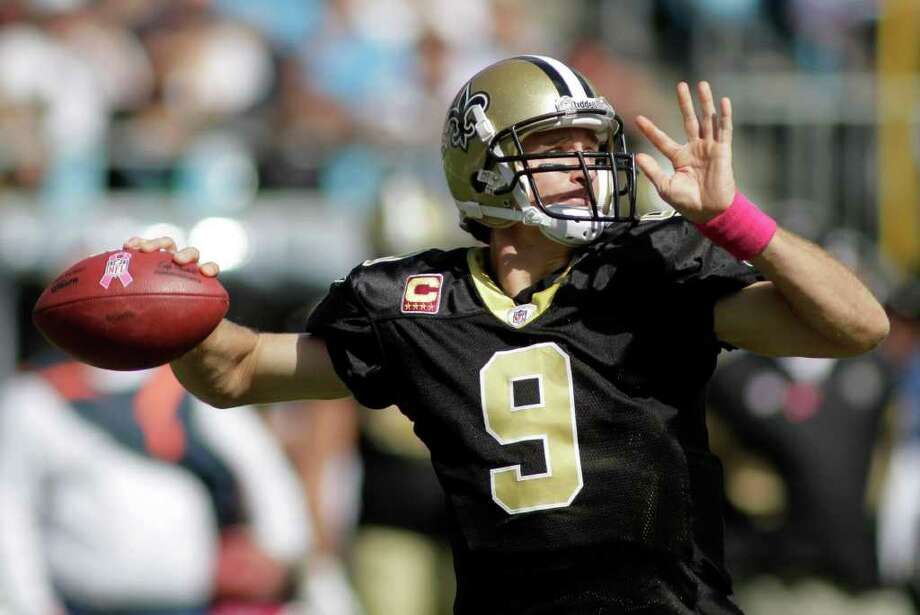 New Orleans Saints' Drew Brees (9) throws a pass against the Carolina Panthers during the second quarter of an NFL football game in Charlotte, N.C., Sunday, Oct. 9, 2011. (AP Photo/Rick Havner) Photo: Rick Havner / FR12831 AP