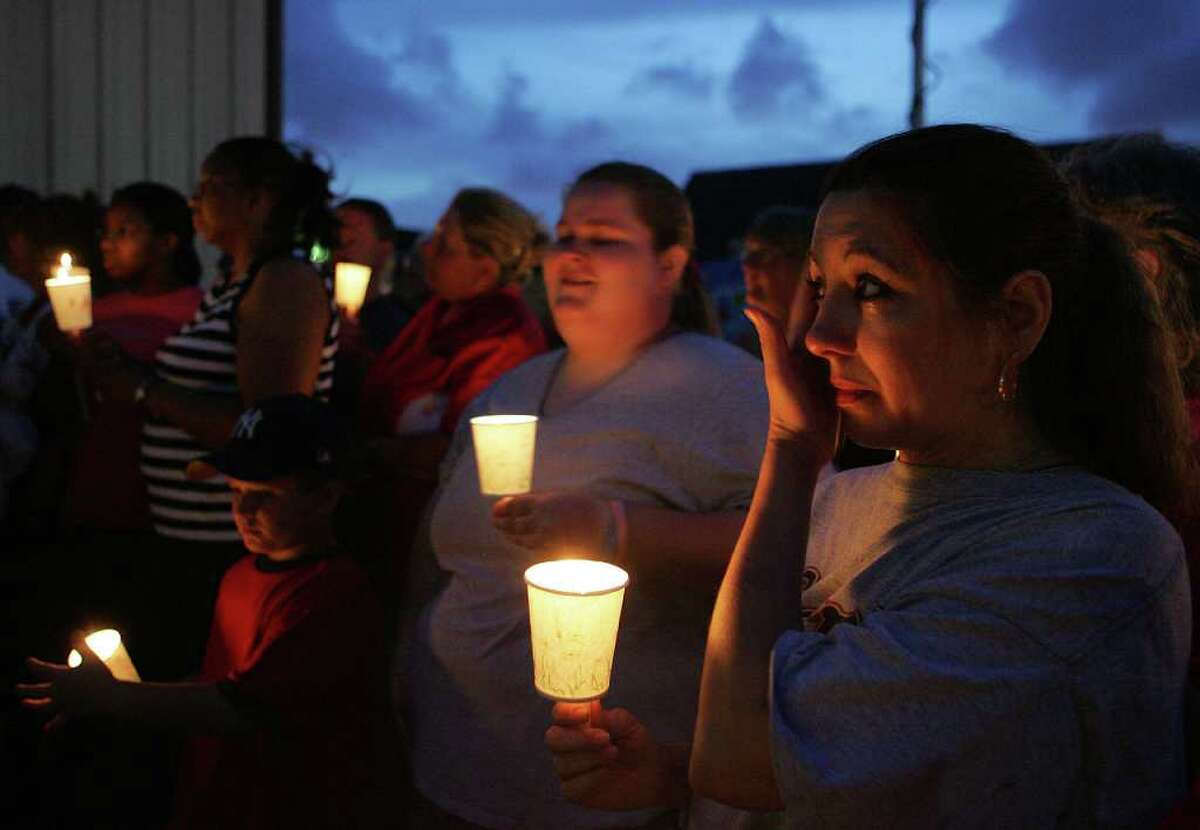 Tina Rogers wipes away tears during a 2006 candlelight vigil for the child at First Assembly of God Church in Channelview.