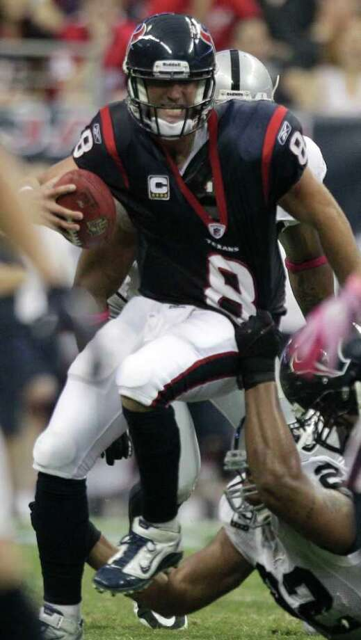 Houston Texans quarterback Matt Schaub (8) is sacked by Oakland Raiders defensive tackle Richard Seymour (92) during the second quarter of an NFL football game at Reliant Stadium on Sunday, Oct. 9, 2011, in Houston. Photo: Brett Coomer, Houston Chronicle / © 2011  Houston Chronicle