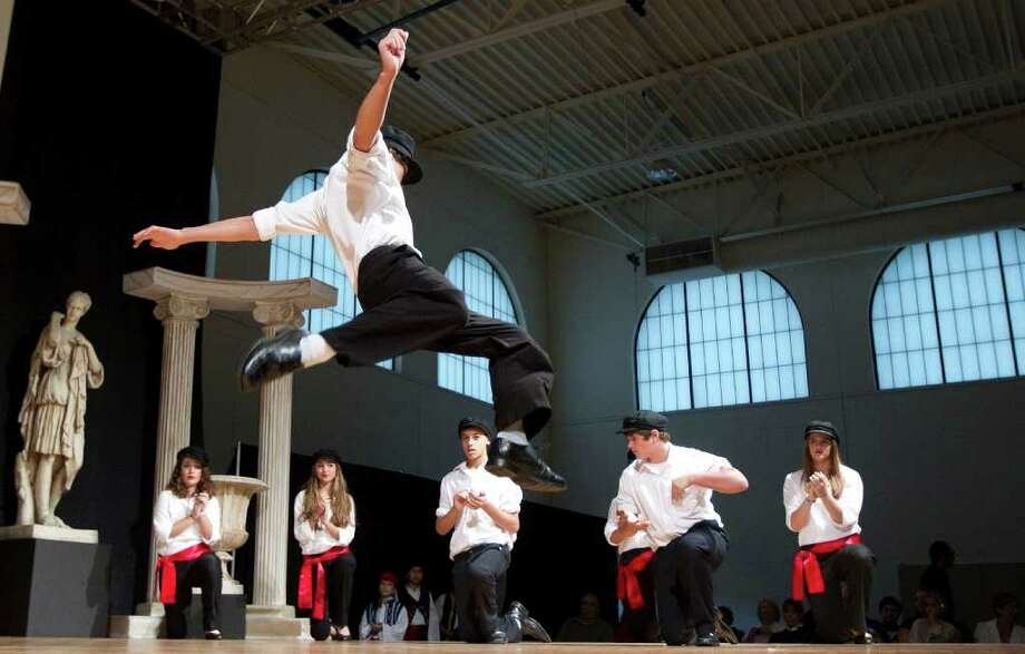 Fifteen-year-old J.D. Pappas jumps in the air during the children's dance program during the 45th Greek Festival presented by the Annunciation Greek Orthodox Cathedral Sunday, Oct. 9, 2011, in Houston. ( James Nielsen / Chronicle ) Photo: James Nielsen / © 2011 Houston Chronicle