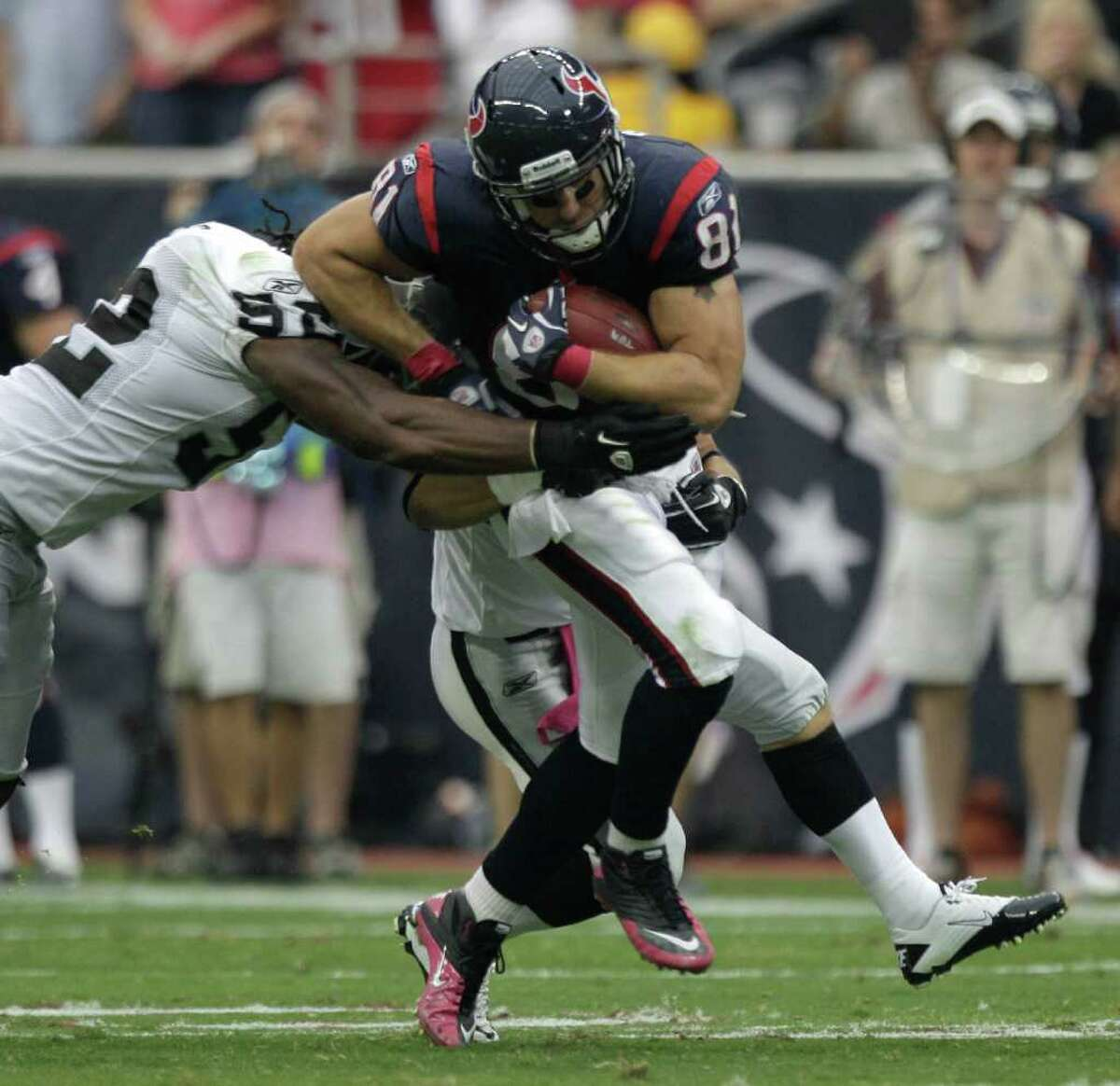 Brett coomer: Chronicle XXXXXXX: Houston Texans tight end Owen Daniels (81) tries to keep his feet under him as Oakland Raiders linebacker Travis Goethel (50) tries to tackle him during the second quarter of an NFL football game at Reliant Stadium on Sunday, Oct. 9, 2011, in Houston. ( Brett Coomer / Houston Chronicle )
