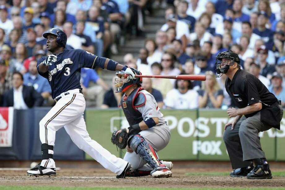 MILWAUKEE, WI - OCTOBER 09:  Yuniesky Betancourt #3 of the Milwaukee Brewers hits a 2-run home run in the bottom of the fifth inning against the St. Louis Cardinals during Game one of the National League Championship Series at Miller Park on October 9, 2011 in Milwaukee, Wisconsin. Photo: Christian Petersen, Getty / 2011 Getty Images