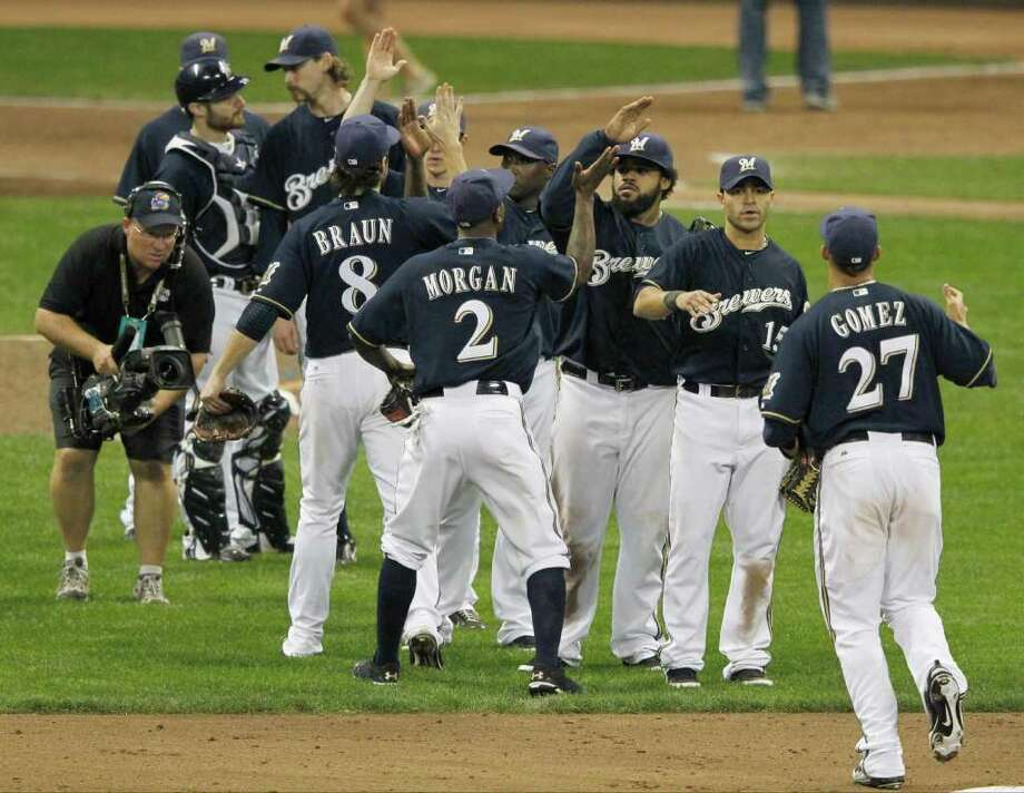 Game 1: Brewers 9, Cardinals 6. The Milwaukee Brewers celebrate after Game 1 of baseball's National League championship series Sunday, Oct. 9, 2011, in Milwaukee. The Brewers won 9-6. (AP Photo/Jeff Roberson) Photo: Jeff Roberson, Associated Press / AP