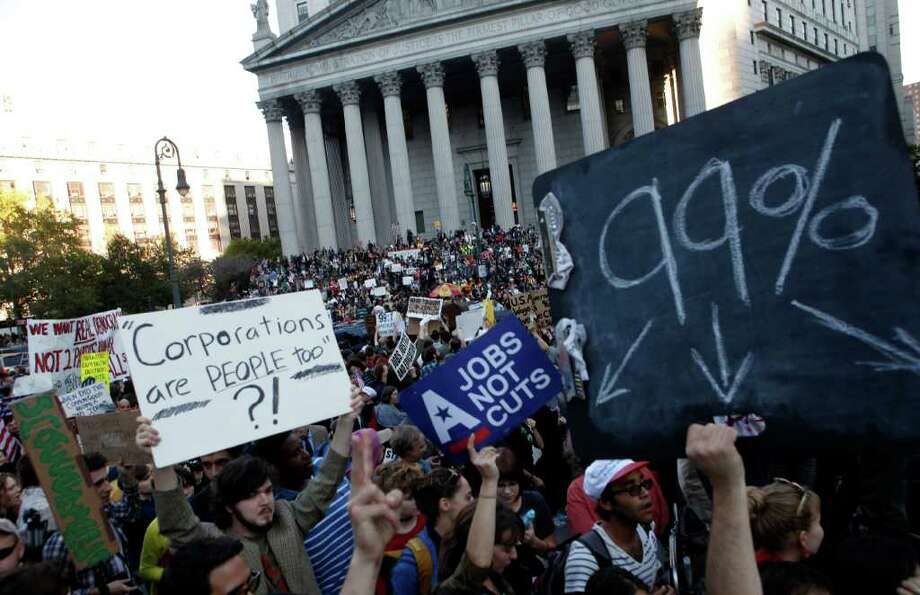 Occupy Wall Street protesters join a labor union rally in Foley Square before marching on Zuccotti Park in New York's Financial District, Wednesday, Oct. 5, 2011. (AP Photo/Jason DeCrow) Photo: Jason DeCrow / FR103966 AP