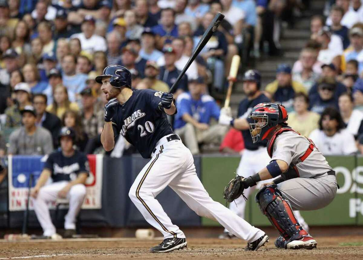 MILWAUKEE, WI - OCTOBER 09: Jonathan Lucroy #20 of the Milwaukee Brewers hits a RBI single in the bottom of the seventh inning against the St. Louis Cardinals during Game one of the National League Championship Series at Miller Park on October 9, 2011 in Milwaukee, Wisconsin. (Photo by Christian Petersen/Getty Images)