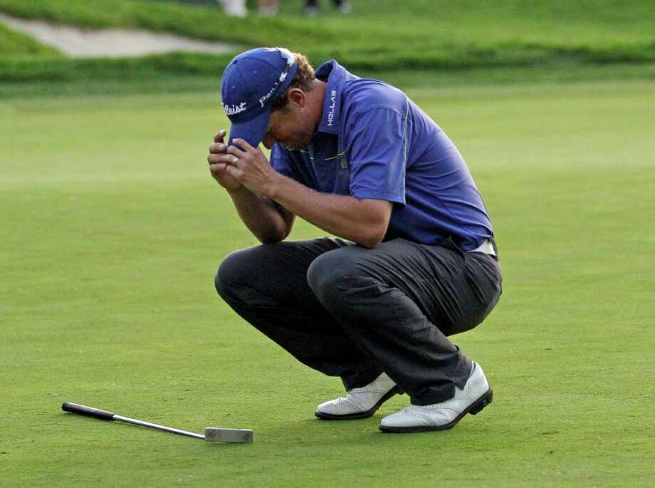 MARCIO JOSE SANCHEZ: AP WAITING AND WAITING: After playing in 132 events and going six playoff holes Sunday, Bryce Molder tastes victory for the first time on the PGA Tour. Photo: Marcio Jose Sanchez / AP