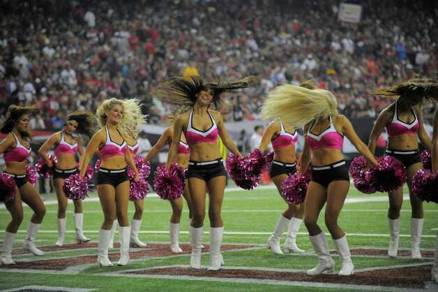 Atlanta Falcons cheerleaders perform during the first half of an NFL football game against the Green Bay Packers, Sunday, Oct. 9, 2011, in Atlanta.  (AP Photo/Pouya Dianat) Photo: Pouya Dianat, Associated Press / FR170555AP