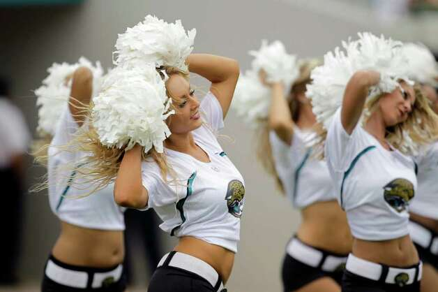 Jacksonville Jaguars cheerleaders perform during the second half of an NFL football game against the Cincinnati Bengals, Sunday, Oct. 9, 2011, in Jacksonville, Fla. Cincinnati won 30-20.(AP Photo/John Raoux) Photo: John Raoux, Associated Press / AP