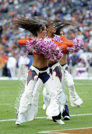 Denver Broncos cheerleaders perform during an NFL football game between the Denver Broncos and the San Diego Chargers , Sunday, Oct. 9, 2011, in Denver.  (AP Photo/Jack Dempsey) Photo: Jack Dempsey, Associated Press / FR42408 AP