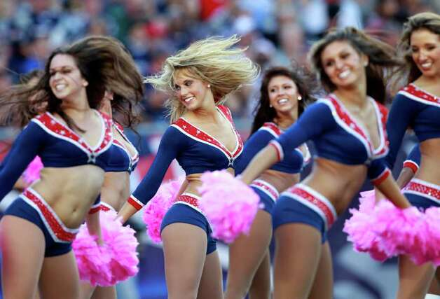 New England Patriots cheerleaders perform at an NFL football game against the New York Jets in Foxborough, Mass., Sunday, Oct. 9, 2011. (AP Photo/Elise Amendola) Photo: Elise Amendola, Associated Press / AP