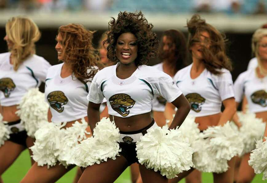Members of the Jacksonville Jaguars Roar cheerleaders perform before kickoff of an NFL football game