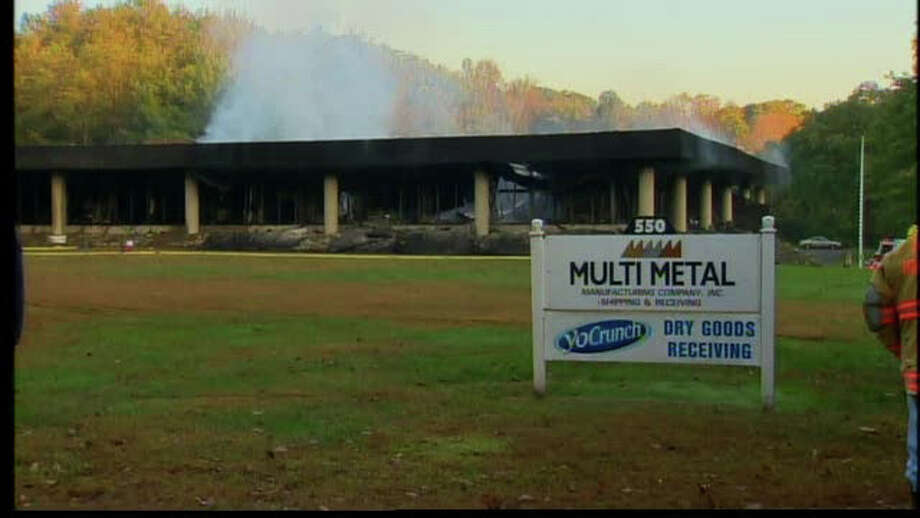 A fire in Naugatuck on Saturday, October 8, 2011, destroyed an office building, causing the roof to collapse. Photo: Contributed Photo