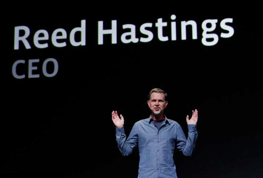 FILE - In this Sept. 22, 2011 file photo, Netflix CEO Reed Hastings gestures during the Facebook f/8 conference in San Francisco. Hastings said Monday, Oct. 10, 2011, it's abandoning its widely panned decision to separate its DVD-by-mail and Internet streaming accounts. (AP Photo/Paul Sakuma, File) Photo: Paul Sakuma / AP2011
