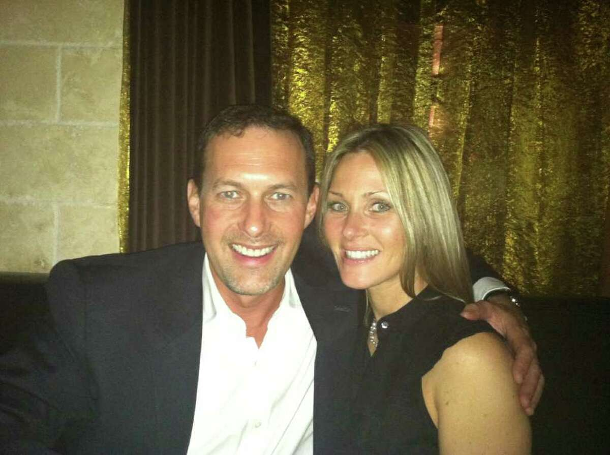 CAPTION: Dr. Craig Fischer, a prominent Houston surgeon, has dropped a lawsuit against his former fiancé for the return of a $73,000, 4-carat engagement ring he gave her before she broke off the engagement, court records show. Fischer is pictured at left. His fiancée, Nichole L. Johnson, is at right. COURTESTY: Craig Fischer