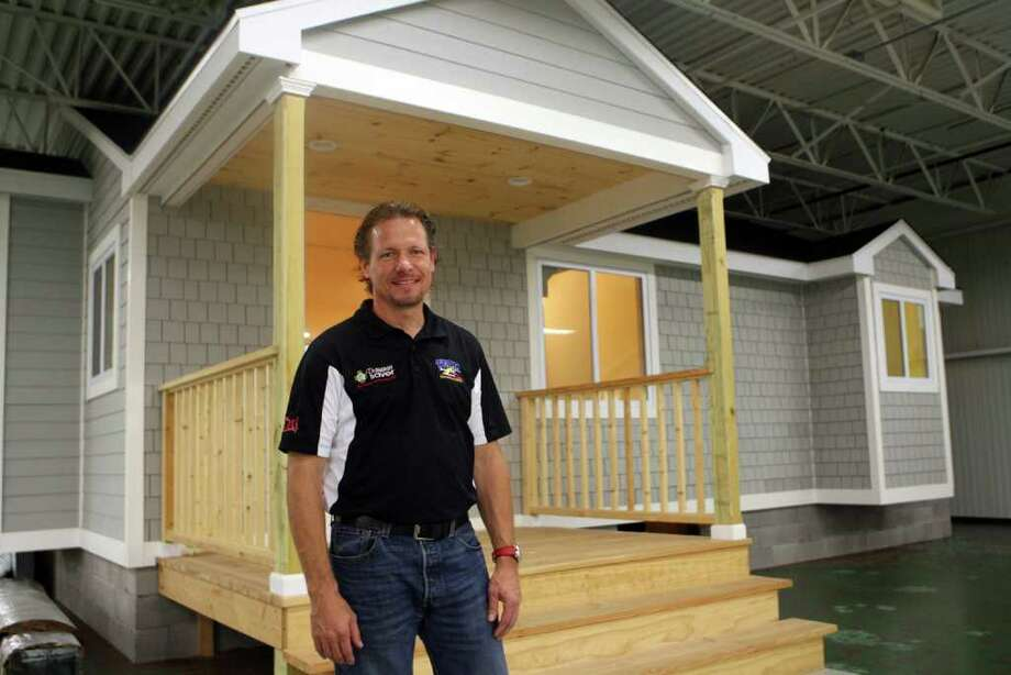 Larry Janesky, owner of Basement System in Seymour, stands by a 2 bedroom house that is used for testing energy efficiency on Monday, October 10, 2011. Dr. Energy Saver, a home energy-saving service,  is the newest addition to his business. Photo: B.K. Angeletti / Connecticut Post