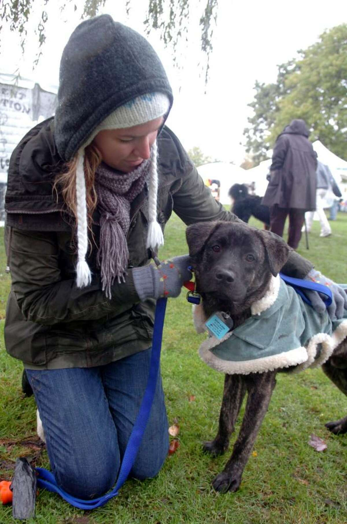 Greenwich, Oct. 18, 2009. Kaitlin Neary, a volunteer at Adopt-A-Dog, with Bishop, 11 months old. Kaitlin has decided to adopt Bishop.