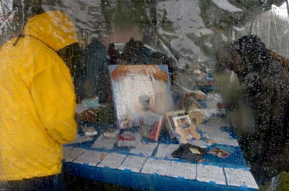 Greenwich, Oct. 18, 2009.  The silent auction tent at the Adopt-A-Dog's Puttin on the Dog Show in the rain. Photo: Helen Neafsey / Greenwich Time