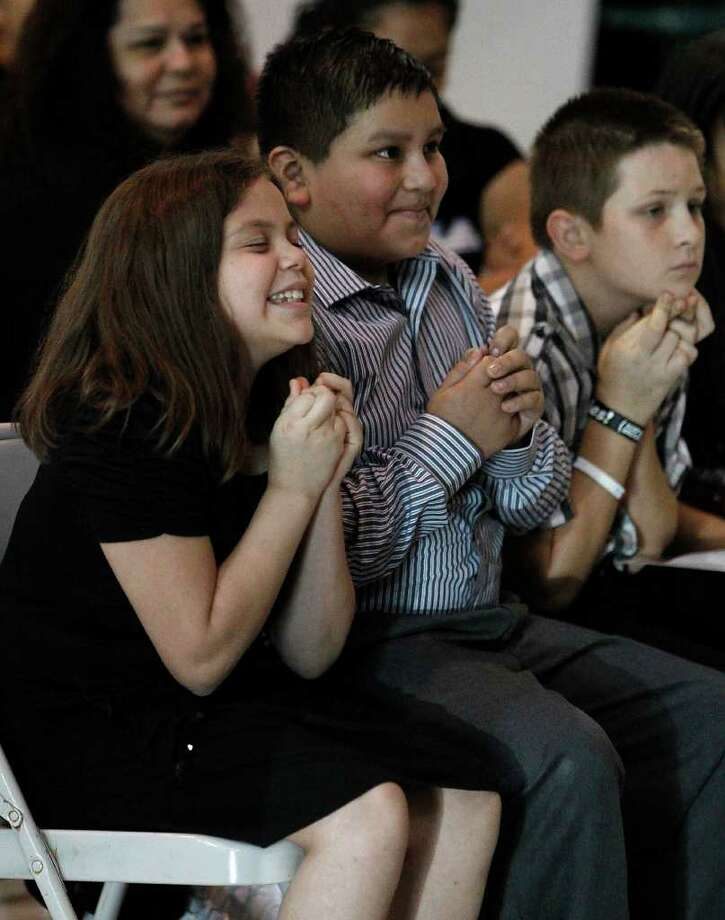 Jasmine Gutierrez, Rodrigo Guerrerro and Isaih Arellano anxiously await the results of their MLK speeches at Park Place Elementary School.  Guerrerro came in first and Gutierrez came in second place. A select group of 4th and 5th grade students at Park Place competed for a single spot in the upcoming 16th Annual Gardere MLK Jr. Oratory Competition. Photo: Karen Warren, Houston Chronicle / © 2011 Houston Chronicle