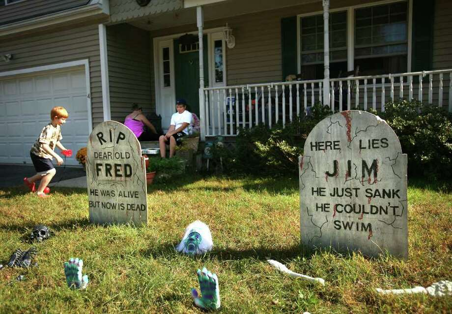The Halloween display in front of Tracy Casey's home at 4 Amber Lane in Milford is under fire by Republicans who say it mocks late mayor Fred Lisman and current mayor James Richetelli. Photo: Brian A. Pounds / Connecticut Post