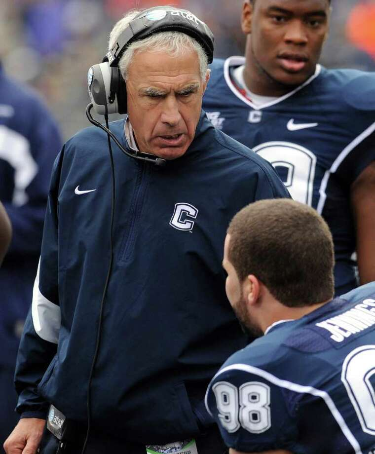 This Oct. 1, 2011 file photo shows Connecticut coach Paul Pasqualoni speaking with Ted Jennings (98) in the first quarter of an NCAA college football game against Western Michigan, in East Hartford, Conn. Pasqualoni says he tries to ignore the building chatter that he could be a one year-and done head coach at Connecticut unless the Huskies' season takes a dramatic turn for the better.  (AP Photo/Jessica Hill, File) Photo: Jessica Hill, Associated Press / AP2011