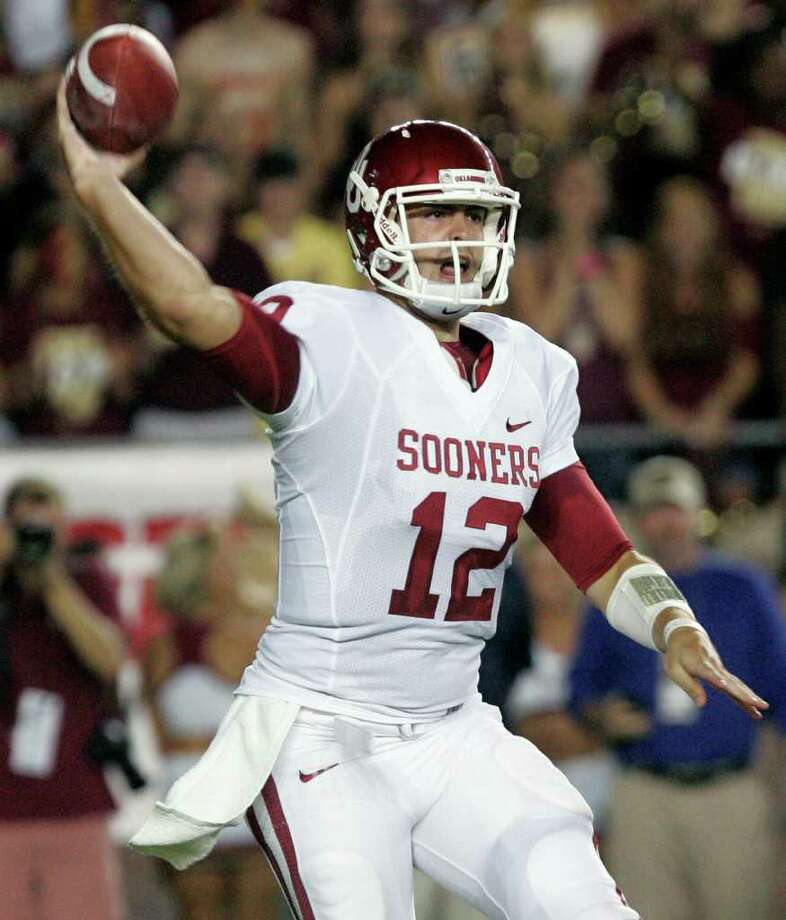 FILE - This Sept. 17, 2011 file photo shows Oklahoma quarterback Landry Jones (12) firing a first quarter pass during an NCAA college football game against Florida State,  in Tallahassee, Fla. The SEC may get most of the attention, at least on offense, but Brandon Weeden, and Landry Jones and Co. are showing they know how to wing the ball in the Midwest, too.(AP Photo/Steve Cannon, File ) Photo: Steve Cannon / AP2011