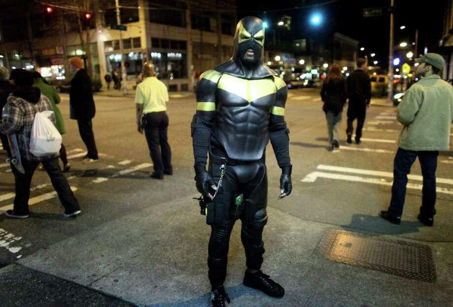 SEATTLEPI.COM FOILED: Seattle superhero Phoenix Jones was arrested and booked into King County Jail early Sundayon four counts of assault. Photo: Joshua Trujillo / seattlepi.com
