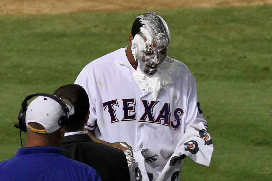 ARLINGTON, TX - OCTOBER 10:  Nelson Cruz #17 of the Texas Rangers is seen after being hit with shaving cream following his walk off grand slam home run in the bottom of the 11th inning to win Game Two of the American League Championship Series 7-3 against the Detroit Tigers at Rangers Ballpark in Arlington on October 10, 2011 in Arlington, Texas. Photo: Ronald Martinez, Getty / 2011 Getty Images