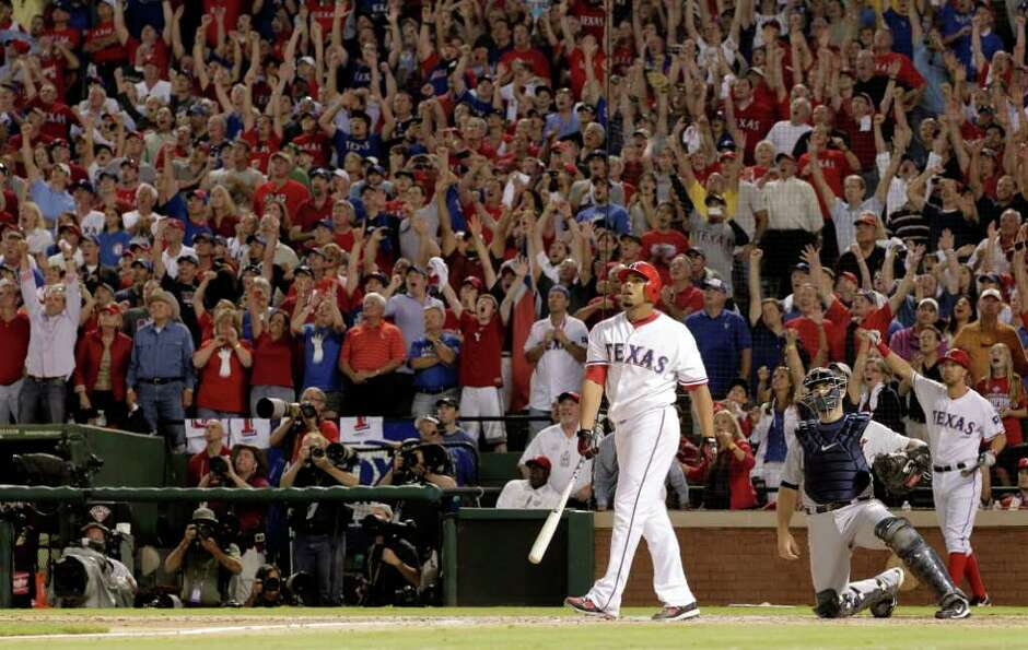 Texas Rangers' Nelson Cruz watches the grand slam home run off of the Detroit Tigers' Ryan Perry tha