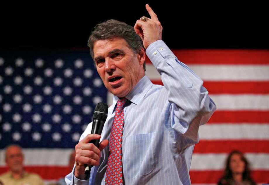Republican presidential candidate, Texas Gov. Rick Perry gestures during an address during a campaign stop in Derry, N.H., Friday, Sept. 30, 2011. (AP Photo/Charles Krupa) Photo: Charles Krupa / AP