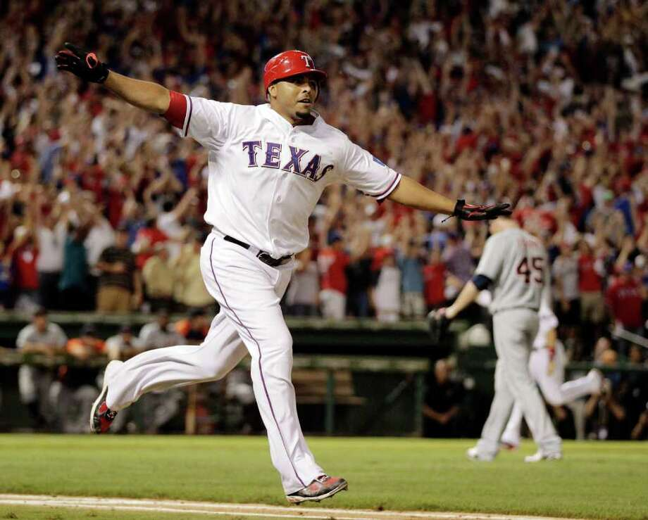 Texas Rangers' Nelson Cruz reacts after hitting a grand slam home run off of Detroit Tigers Ryan Perry, rear to win Game 2 of baseball's American League championship series 7-3,  Monday, Oct. 10, 2011, in Arlington, Texas. (AP Photo/Charlie Riedel) Photo: Charlie Riedel, Associated Press / AP