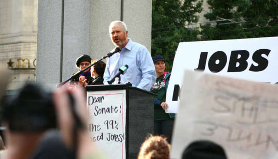 Mayor Mike McGinn speaks Monday to the Occupy Seattle movement at Westlake Center. Photo: Chris Grygiel