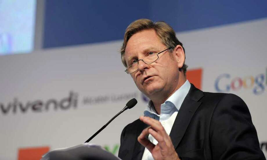 FILES - Picture taken on May 24, 2011 shows Bertelsmann's chairman and CEO Hartmut Ostrowski during a session of the e-G8 Forum in Paris. Ostrowski, 53, will leave his post by January 2012 and change to the group's supervisory board, it was announced on October 10, 2011.    AFP PHOTO  ERIC PIERMONT (Photo credit should read ERIC PIERMONT/AFP/Getty Images) Photo: ERIC PIERMONT / AFP