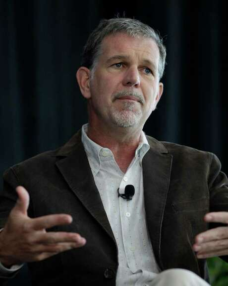 FILE - This Aug. 2, 2011 file photo shows Netflix CEO Reed Hastings speaking at a meeting in Palo Alto, Calif. In a few weeks, Netflix subscribers who want to get DVDs by mail will go to a separate website to access Qwikster. The streaming business will continue to be called Netflix. Members who subscribe to both services will have two entries on their credit card statements. Instead of Netflix, the distinctive red envelopes will now say Qwikster. (AP Photo/Paul Sakuma, File) Photo: Paul Sakuma / AP2011