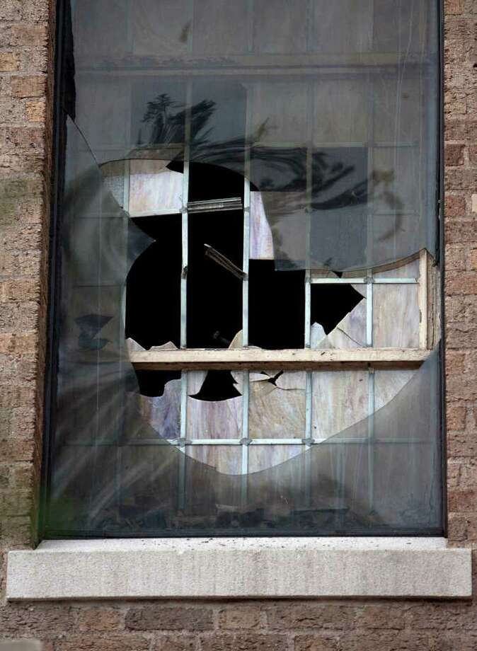 More fire damage. The searing heat caused some of the church's stained-glass windows to burst. • More: Church has much to celebrate Photo: Cody Duty / © 2011 Houston Chronicle