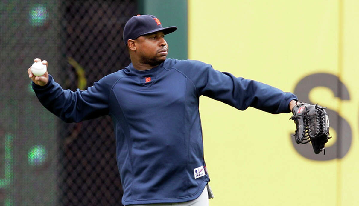 Detroit Tigers' Delmon Young throws before Game 2 of baseball's American League championship series against the Texas Rangers Monday, Oct. 10, 2011, in Arlington.